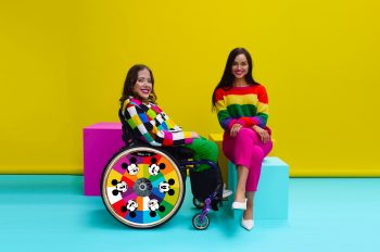 Izzy in Wheelchair and sister